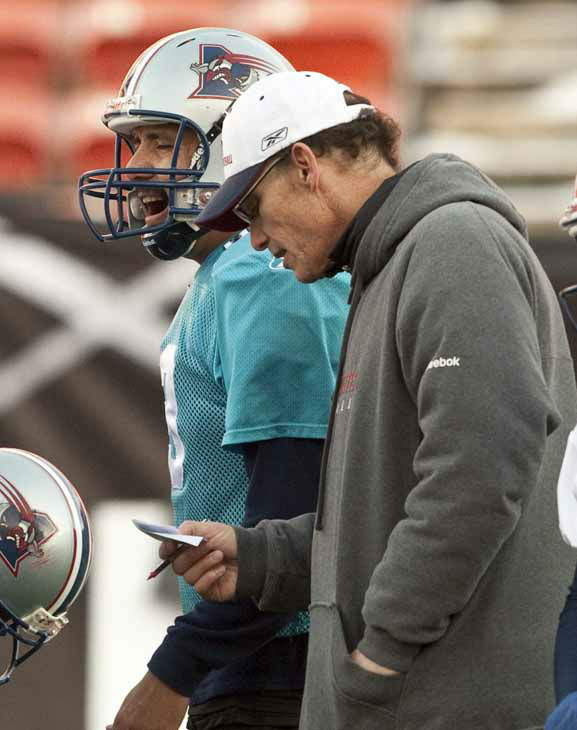 Montreal Alouettes head coach Marc Trestman, right, talks with quarterback Anthony Calvillo during Canadian Football League practice, Friday, Nov. 26, 2010 in Edmonton, Alberta.   &#40;AP Photo&#47;The Canadian Press, Adrian Wyld&#41; <span class=meta>(AP Photo&#47; Adrian Wyld)</span>