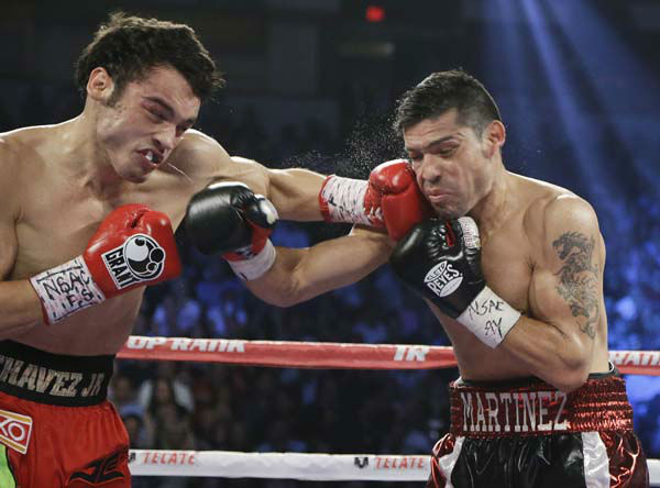 Julio Cesar Chavez Jr., left, lands a punch against Sergio Martinez during the WBC middleweight title fight, Saturday, Sept. 15, 2012, in Las Vegas. Martinez won by unanimous decision. &#40;AP Photo&#47;Julie Jacobson&#41; <span class=meta>(AP Photo&#47; Julie Jacobson)</span>