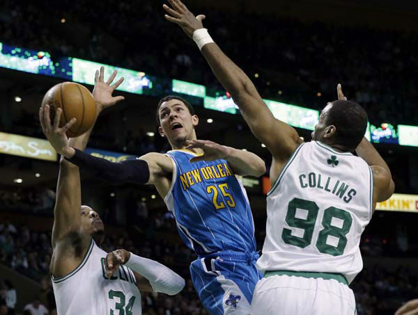 New Orleans Hornets shooting guard Austin Rivers &#40;25&#41; drives to the hoop between Boston Celtics small forward Paul Pierce &#40;34&#41; and center Jason Collins &#40;98&#41; during the second quarter of an NBA basketball game in Boston, Wednesday, Jan. 16, 2013. &#40;AP Photo&#47;Elise Amendola&#41; <span class=meta>(AP Photo&#47; Elise Amendola)</span>