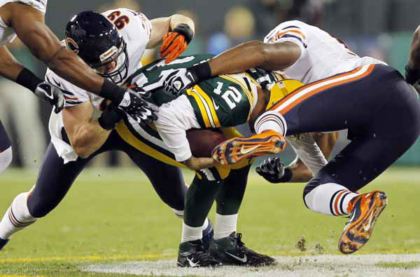 Chicago Bears&#39; Corey Wootton &#40;98&#41; and  Shea McClellin &#40;99&#41; sack Green Bay Packers quarterback Aaron Rodgers during the first half of an NFL football game Thursday, Sept. 13, 2012, in Green Bay, Wis. &#40;AP Photo&#47;Mike Roemer&#41; <span class=meta>(AP Photo&#47; Mike Roemer)</span>