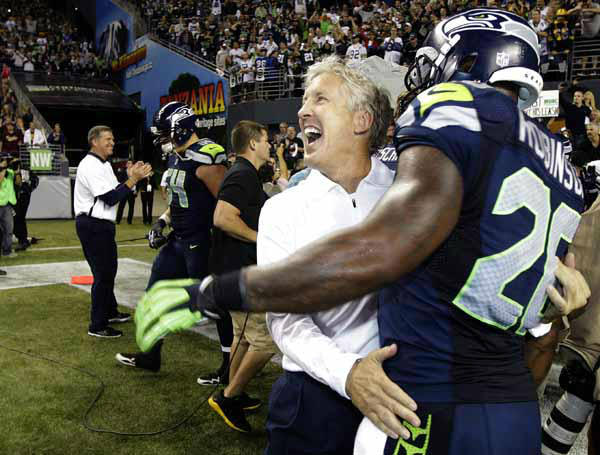 Seattle Seahawks head coach Pete Carroll, second from right, celebrates with Seahawks&#39; Michael Robinson after defeating the Green Bay Packers 14-12 an NFL football game, Monday, Sept. 24, 2012, in Seattle. &#40;AP Photo&#47;Ted S. Warren&#41; <span class=meta>(AP Photo&#47; Ted S. Warren)</span>