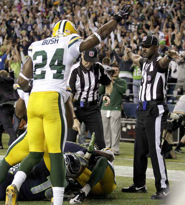 "<div class=""meta ""><span class=""caption-text "">Officials decide on a call for the final play of the game as Green Bay Packers' Jarrett Bush (24) reacts in the second half of an NFL football game, Monday, Sept. 24, 2012, in Seattle. After a period of review, the play stood as a Seattle touchdown as the Seahawks defeated the Packers 14-12. (AP Photo/Stephen Brashear) (AP Photo/ Stephen Brashear)</span></div>"