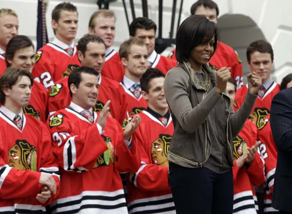 "First Lady Michelle Obama holds a ""Let's Move!"" street hockey event with the 2010 Stanley Cup Champions Chicago Blackhawks and area students on the South Lawn of the White House in Washington, Friday, March 11, 2011. (AP Photo/Charles Dharapak)"