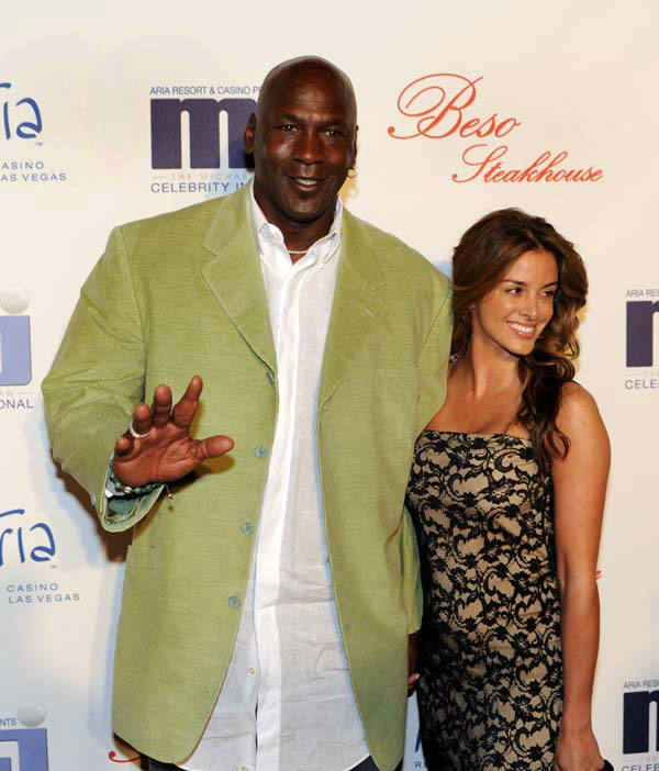 In this photo provided by the Las Vegas News Bureau, basketball great Michael Jordan and his girlfriend Yvette Prieto arrive for a celebrity dinner at Beso inside Crystals in City Center in Las Vegas. The former NBA star and Charlotte Bobcats owner appeared at the main Palm Beach County courthouse Thursday morning, March 7, 2013 to apply for a marriage license, according to Kathy Burstein, a spokeswoman for the clerk&#39;s office. &#40;AP Photo&#47;Las Vegas News Bureau, Brian Jones&#41; <span class=meta>(AP Photo&#47; Brian Jones)</span>