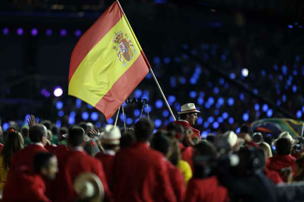 Spain&#39;s Pau Gasol carries the flag during the Opening Ceremony at the 2012 Summer Olympics, Friday, July 27, 2012, in London. &#40;AP Photo&#47;David Goldman&#41; <span class=meta>(AP Photo&#47; David Goldman)</span>