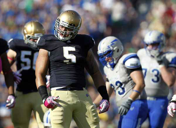 Notre Dame linebacker Manti Te&#39;o &#40;5&#41; reacts to making a stop against Air Force during the first half of an NCAA college football game in South Bend, Ind., Saturday, Oct. 8, 2011. &#40;AP Photo&#47;Michael Conroy&#41; <span class=meta>(AP Photo&#47; Michael Conroy)</span>