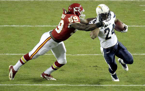 San Diego Chargers running back Ryan Mathews, right, runs for an 18-yard gain before being brought down by Kansas City Chiefs linebacker Jovan Belcher during the first quarter of an NFL football game Monday, Oct. 31, 2011, in Kansas City, Mo. &#40;AP Photo&#47;Charlie Riedel&#41; <span class=meta>(AP Photo&#47; Charlie Riedel)</span>