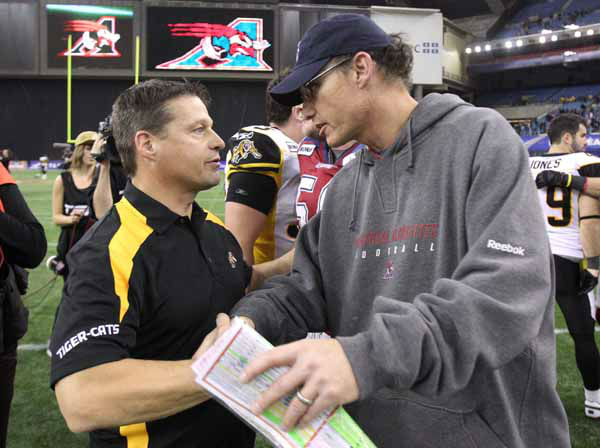 Montreal Alouettes head coach Marc Trestman, right, congratulates his Hamilton Tiger-Cats counterpart Marcel Bellefeuille following Hamilton&#39;s victory in the CFL East Division semifinal Sunday, November 13, 2011 in Montreal.  &#40;THE CANADIAN PRESS&#47;Tom Boland&#41; <span class=meta>(Photo&#47;Tom Boland)</span>