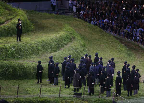 during the Opening Ceremony at the 2012 Summer Olympics, Friday, July 27, 2012, in London. &#40;AP Photo&#47;Charlie Riedel&#41; <span class=meta>(AP Photo&#47; Charlie Riedel)</span>