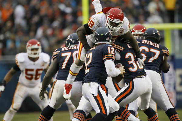 Kansas City Chiefs inside linebacker Jovan Belcher &#40;59&#41; pressures Chicago Bears quarterback Caleb Hanie &#40;12&#41; in the second half of an NFL football game in Chicago, Sunday, Dec. 4, 2011. &#40;AP Photo&#47;Charles Rex Arbogast&#41; <span class=meta>(AP Photo&#47; Charles Rex Arbogast)</span>