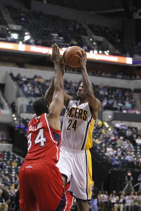 Indiana Pacers guard Paul George shoots over Atlanta Hawks center Jason Collins in the second half of an NBA basketball game in Indianapolis, Wednesday, Jan. 11, 2012. The Pacers defeated the Hawks 96-84. &#40;AP Photo&#47;Michael Conroy&#41; <span class=meta>(AP Photo&#47; Michael Conroy)</span>