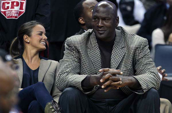Charlotte Bobcats owner Michael Jordan, right, sits with his fiancee, Yvette Prieto, left, during the first half of an NBA basketball game between the Charlotte Bobcats and the Golden State Warriors in Charlotte, N.C., Saturday, Jan. 14, 2012. &#40;AP Photo&#47;Chuck Burton&#41; <span class=meta>(AP Photo&#47; Chuck Burton)</span>