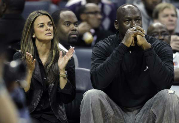 Charlotte Bobcats owner Michael Jordan, right, sits with his fiance Yvette Prieto, left, during the first half of an NBA basketball game between the Charlotte Bobcats and the Cleveland Cavaliers in Charlotte, N.C., Monday, Jan. 16, 2012. &#40;AP Photo&#47;Chuck Burton&#41; <span class=meta>(AP Photo&#47; Chuck Burton)</span>