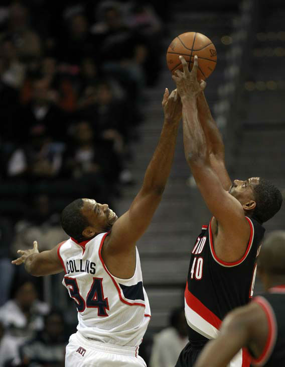 Atlanta Hawks center Jason Collins &#40;34&#41; and Portland Trail Blazers center Kurt Thomas &#40;40&#41; fight for a rebound in the first half of an NBA basketball game on Wednesday, Jan. 18, 2012, in Atlanta. Atlanta won 92-89. &#40;AP Photo&#47;John Bazemore&#41; <span class=meta>(AP Photo&#47; John Bazemore)</span>