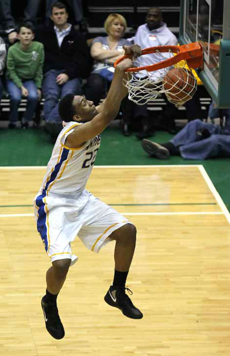 "<div class=""meta ""><span class=""caption-text "">In this photo taken in Chicago, Friday, Feb. 17, 2012, Jabari Parker dunks the ball during the City basketball Championship game against Proviso East. (AP Photo/Charles Rex Arbogast) (AP Photo/ Charles Rex Arbogast)</span></div>"