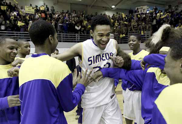In this photo taken in Summit, Ill., on Friday, March 9, 2012, Jabari Parker breaks his solitude on the bench with a smile and acknowledgement from teammates, as he is introduced into an Illinois sectional championship basketball game against Marist. &#40;AP Photo&#47;Charles Rex Arbogast&#41; <span class=meta>(AP Photo&#47; Charles Rex Arbogast)</span>