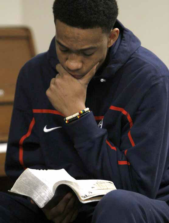 In this photo taken in Chicago, Monday, March 12, 2012, high school basketball phenom Jabari Parker looks up scripture during a youth Bible study at the  Church of Jesus Christ of Latter-day Saints seminary in Chicago&#39;s Hyde Park neighborhood. Parker, chooses to wake up around 5 a.m. three times a week before school and head to the Bible study.  ?It gives me a better view of life,? he says. &#40;AP Photo&#47;Charles Rex Arbogast&#41; <span class=meta>(AP Photo&#47; Charles Rex Arbogast)</span>