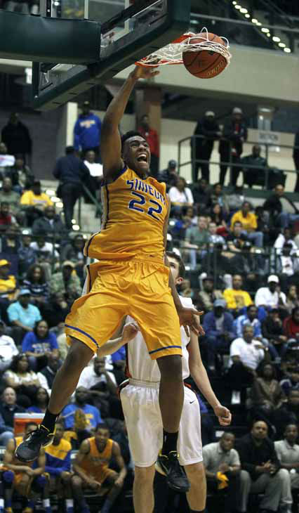 In this photo taken in Chicago, on Tuesday, March 13, 2012, Simeon&#39;s Jabari Parker dunks the ball during an Illinois state super sectional playoff basketball game against Evanston. &#40;AP Photo&#47;Charles Rex Arbogast&#41; <span class=meta>(AP Photo&#47; Charles Rex Arbogast)</span>