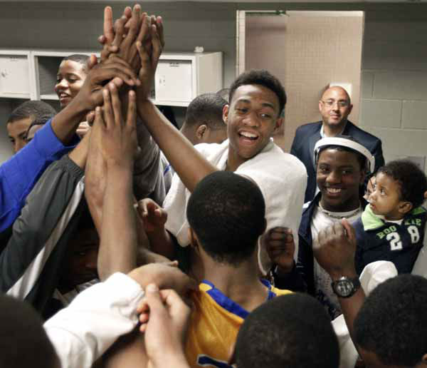 In this photo taken in Chicago on Tuesday, March 13, 2012, Jabari Parker celebrates with his Simeon Career Academy teammates after winning an Illinois state super sectional basketball playoff game. For all the attention Jabari gets, Simeon coach Robert Smith says: ?He doesn&#39;t want this to be about him. He wants it to be about the team.? &#40;AP Photo&#47;Charles Rex Arbogast&#41; <span class=meta>(AP Photo&#47; Charles Rex Arbogast)</span>
