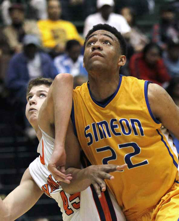 FILE - In this March 13, 2012 file photo, Simeon Career Academy&#39;s forward Jabari Parker &#40;22&#41; fights for position in an Illinois state basketball super-sectional game against Evanston High Schoo in Chicago. On Wednesday, July 11, 2012, Parker tweeted the 10 schools in no particular order he is considering with a year to go before he graduates from high school. They are: national champion Kentucky, Stanford, Michigan State, Kansas, Florida, Duke, BYU, Georgetown, DePaul and North Carolina. &#40;AP Photo&#47;Charles Rex Arbogast, File&#41; <span class=meta>(AP Photo&#47; Charles Rex Arbogast)</span>