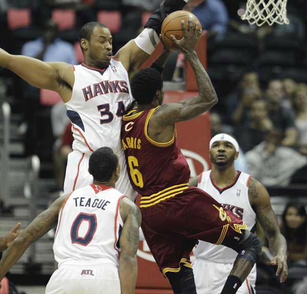 Atlanta Hawks&#39; Jason Collins, left, and Cleveland Cavaliers guard Manny Harris &#40;6&#41; plays during an NBA basketball game Wednesday, March 21, 2012, in Atlanta. &#40;AP Photo&#47;David Goldman&#41; <span class=meta>(AP Photo&#47; David Goldman)</span>