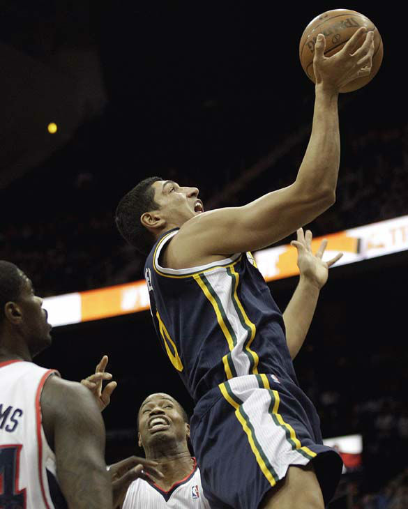 Utah Jazz&#39;s Enes Kanter, right puts up a shot past Atlanta Hawks&#39; Jason Collins, rear, and Marvin Williams, left, during the second quarter of an NBA basketball game Sunday, March 25, 2012, in Atlanta. &#40;AP Photo&#47;David Goldman&#41; <span class=meta>(AP Photo&#47; David Goldman)</span>
