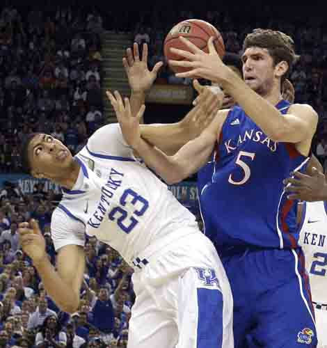 "<div class=""meta ""><span class=""caption-text "">Kentucky forward Anthony Davis (23) battles for the ball with Kansas center Jeff Withey (5) during the first half of the NCAA Final Four tournament college basketball championship game Monday, April 2, 2012, in New Orleans. (AP Photo/David J. Phillip) (AP Photo/ David J. Phillip)</span></div>"