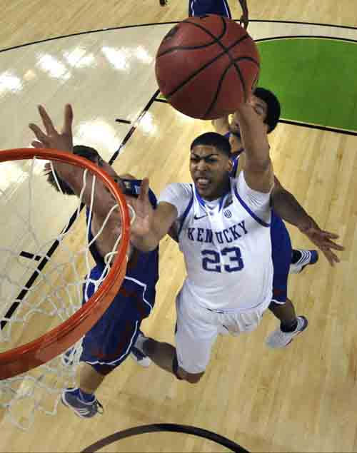 Kentucky forward Anthony Davis &#40;23&#41; drives ot the basket in front of Kansas center Jeff Withey, left, and forward Thomas Robinson, behind, during the second half of an NCAA Final Four college basketball tournament championship game Monday, April 2, 2012, in New Orleans. &#40;AP Photo&#47;Chris Steppig&#47;NCAA Photos, Pool&#41; <span class=meta>(AP Photo&#47; Chris Steppig)</span>