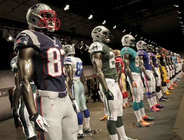 "<div class=""meta ""><span class=""caption-text "">New NFL uniforms are displayed on mannequins during a presentation in New York, Tuesday, April 3, 2012.  The NFL and Nike showed off the new look in grand style with a gridiron-styled fashion show at a Brooklyn film studio. (AP Photo/Seth Wenig) (AP Photo/ Seth Wenig)</span></div>"