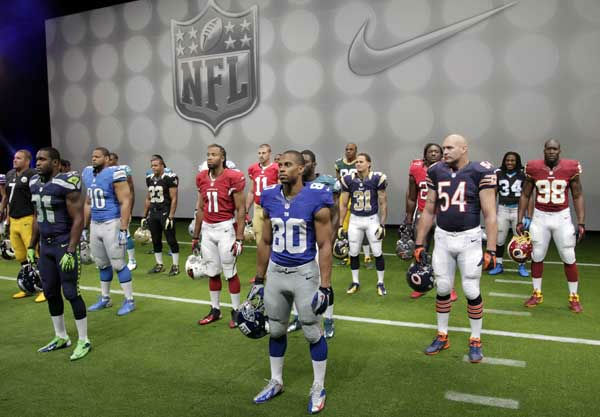 "<div class=""meta ""><span class=""caption-text "">NFL players stand in their new uniforms during a presentation in New York, Tuesday, April 3, 2012. The league and Nike showed off the new look in grand style with a gridiron-styled fashion show at a Brooklyn film studio. (AP Photo/Seth Wenig) (AP Photo/ Seth Wenig)</span></div>"