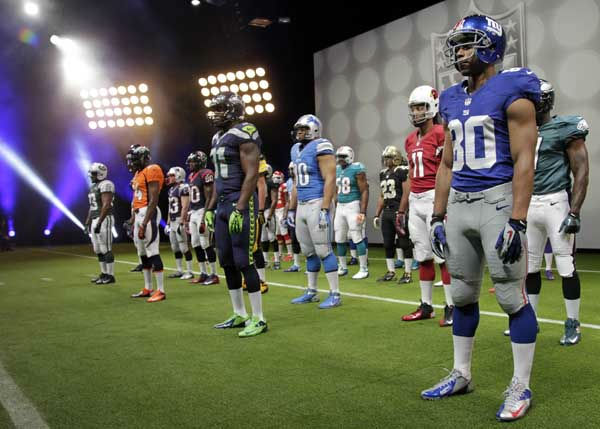 NFL uniforms are displayed during a presentation in New York, Tuesday, April 3, 2012. The league and Nike showed off the new look in grand style Tuesday with a gridiron-styled fashion show at a Brooklyn film studio. &#40;AP Photo&#47;Seth Wenig&#41; <span class=meta>(AP Photo&#47; Seth Wenig)</span>