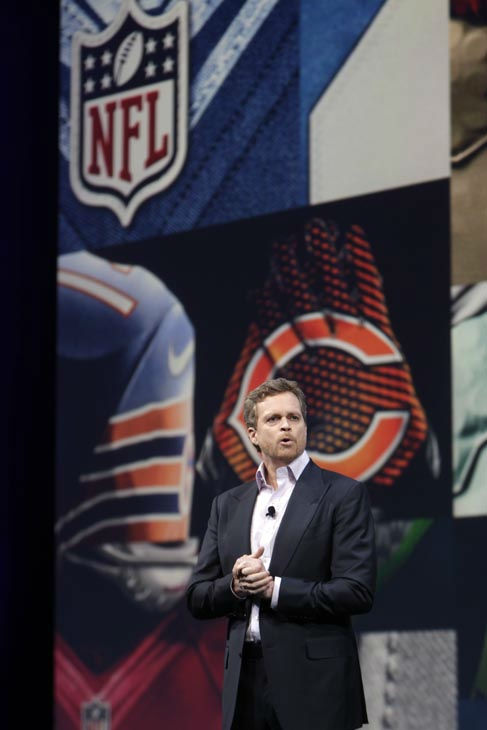 Nike CEO Mark Parker talks to guests during a presentation in New York, Tuesday, April 3, 2012. The NFL and Nike showed off the new look in grand style with a gridiron-styled fashion show at a Brooklyn film studio. &#40;AP Photo&#47;Seth Wenig&#41; <span class=meta>(AP Photo&#47; Seth Wenig)</span>