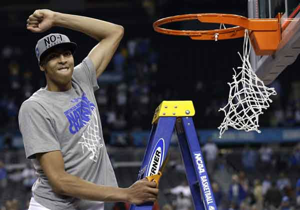 Kentucky forward Anthony Davis celebrates as he cuts the net after the NCAA Final Four tournament college basketball championship game Monday, April 2, 2012, in New Orleans.  Kentucky beat Kansas 67-59.  &#40;AP Photo&#47;David J. Phillip&#41; <span class=meta>(AP Photo&#47; David J. Phillip)</span>