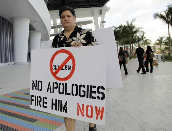 Jay Hernandez of Miami protests outside the Marlins Stadium in Miami, Tuesday April 10, 2012. Miami Marlins manager Ozzie Guillen has been suspended for five games effective immediatly following favorable comments he made about Fidel Castro which infuriated many Cuban-Americans. &#40;AP Photo&#47;Lynne Sladky&#41; <span class=meta>(AP Photo&#47; Lynne Sladky)</span>