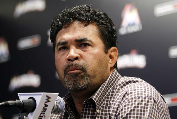 Miami Marlins manager Ozzie Guillen pauses as he speaks at a news conference at Marlins Stadium in Miami, Tuesday April 10, 2012.  Guillen was suspended for five games Tuesday because of his comments about Fidel Castro. Guillen told Time magazine he loves Castro and respects the retired Cuban leader for staying in power so long. At least two local officials said Guillen should lose his job. &#40;AP Photo&#47;Lynne Sladky&#41; <span class=meta>(AP Photo&#47; Lynne Sladky)</span>