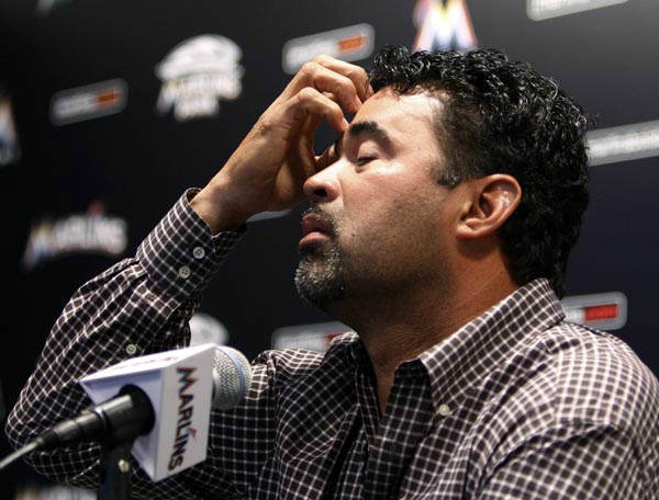 Miami Marlins manager Ozzie Guillen gestures at a news conference at Marlins Stadium in Miami, Tuesday April 10, 2012.  Guillen was suspended for five games Tuesday because of his comments about Fidel Castro. Guillen told Time magazine he loves Castro and respects the retired Cuban leader for staying in power so long. At least two local officials said Guillen should lose his job. &#40;AP Photo&#47;Lynne Sladky&#41; <span class=meta>(AP Photo&#47; Lynne Sladky)</span>