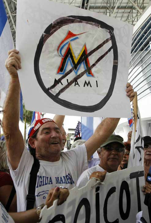 Protestors hold signs outside Marlins Stadium in Miami, where Marlins manager Ozzie Guillen was speaking at a news conference, Tuesday April 10, 2012. Guillen has been suspended for five games because of his comments about Fidel Castro. He has again apologized and says he accepts the punishment.  &#40;AP Photo&#47;Lynne Sladky&#41; <span class=meta>(AP Photo&#47; Lynne Sladky)</span>