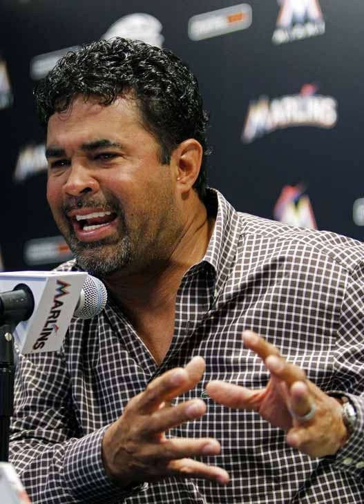 Miami Marlins manager Ozzie Guillen gestures at a news conference at the Marlins Stadium in Miami, Tuesday April 10, 2012.  Guillen was suspended for five games Tuesday because of his comments about Fidel Castro. Guillen told Time magazine he loves Castro and respects the retired Cuban leader for staying in power so long. At least two local officials said Guillen should lose his job.&#40;AP Photo&#47;Lynne Sladky&#41; <span class=meta>(AP Photo&#47; Lynne Sladky)</span>