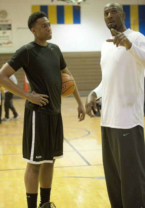 The photo provided by Gatorade shows Jabari Parker, left, of Simeon Career Academy, getting basketball tips from former NBA Champion Alonzo Mourning, after Parker was named the Gatorade National Boys Basketball Player of the Year, Thursday, April 12, 2012 in Chicago, IL. Parker was surprised with the news in Spanish class by Mourning, who earned Gatorade National Boys Basketball Player of the Year honors in 1987-88. &#40;AP Photo&#47;Gatorade,Susan Goldman&#41; <span class=meta>(AP Photo&#47; SUSAN GOLDMAN)</span>