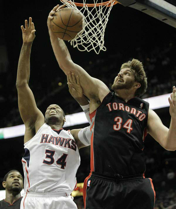 Atlanta Hawks center Jason Collins &#40;34&#41; and Toronto Raptors center Aaron Gray &#40;34&#41; play in an NBA basketball game Sunday, April 15, 2012, in Atlanta. &#40;AP Photo&#47;David Goldman&#41; <span class=meta>(AP Photo&#47; David Goldman)</span>