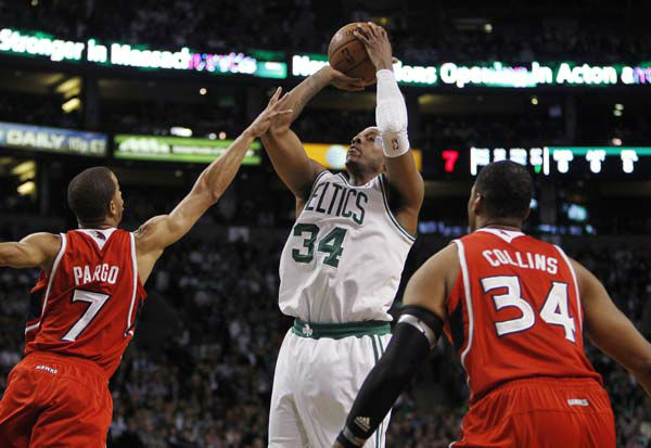 Boston Celtics&#39; Paul Pierce, center, shoots between Atlanta Hawks&#39; Jannero Pargo &#40;7&#41; and Jason Collins during the second quarter of Game 4 of an NBA basketball first-round playoff series, in Boston on Sunday, May 6, 2012. &#40;AP Photo&#47;Michael Dwyer&#41; <span class=meta>(AP Photo&#47; Michael Dwyer)</span>
