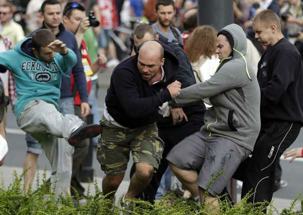 Fans clash prior to the Euro 2012 soccer championship Group A match between Poland and Russia in Warsaw, Poland, Tuesday, June 12, 2012. Russian soccer fans clashed with police and Poland supporters in separate incidents in Warsaw on Tuesday, just hours before the two teams were to meet in an emotionally charged European Championship match. Several people were injured. &#40;AP Photo&#47;Gero Breloer&#41; <span class=meta>(AP Photo&#47; Gero Breloer)</span>