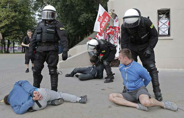"<div class=""meta ""><span class=""caption-text "">Police arrest soccer fans prior to the Euro 2012 soccer championship Group A match between Poland and Russia in Warsaw, Poland, Tuesday, June 12, 2012. Russian soccer fans clashed with police and Poland supporters in separate incidents in Warsaw on Tuesday, just hours before the two teams were to meet in an emotionally charged European Championship match. Several people were injured. (AP Photo/Gero Breloer) (AP Photo/ Gero Breloer)</span></div>"