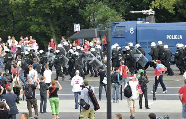 "<div class=""meta ""><span class=""caption-text "">Police bring a water cannon as fans clash prior to the Euro 2012 soccer championship Group A match between Poland and Russia in Warsaw, Poland, Tuesday, June 12, 2012. Russian soccer fans clashed with police and Poland supporters in separate incidents in Warsaw on Tuesday, just hours before the two teams were to meet in an emotionally charged European Championship match. Several people were injured. (AP Photo/Alik Keplicz) (AP Photo/ Alik Keplicz)</span></div>"
