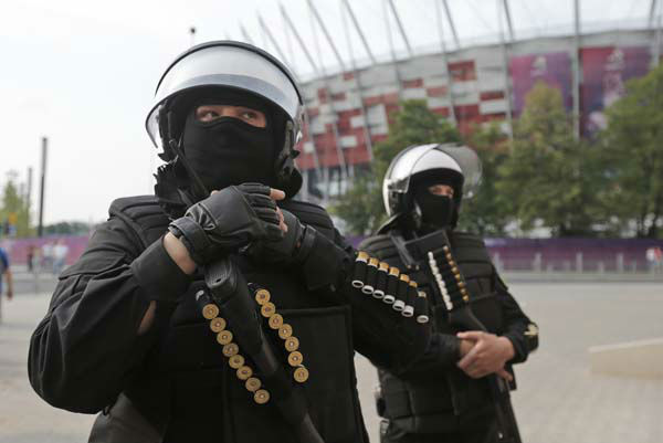 Armed police wait in front of the Warsaw stadium prior to the Euro 2012 soccer championship Group A match between Poland and Russia in Warsaw, Poland, Tuesday, June 12, 2012. Russian soccer fans clashed with police and Poland supporters in separate incidents in Warsaw on Tuesday, just hours before the two teams were to meet in an emotionally charged European Championship match. Several people were injured. &#40;AP Photo&#47;Gero Breloer&#41; <span class=meta>(AP Photo&#47; Gero Breloer)</span>