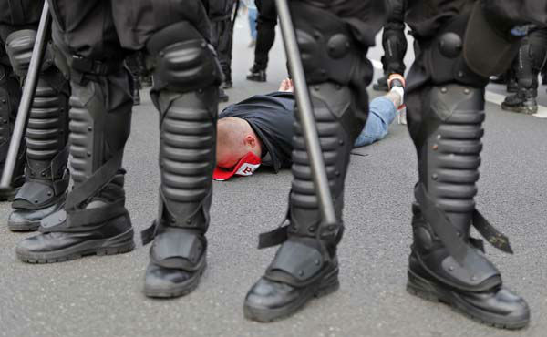 A handcuffed Polish fan lies flat on the street prior to the Euro 2012 soccer championship Group A match between Poland and Russia in Warsaw, Poland, Tuesday, June 12, 2012. Russian soccer fans clashed with police and Poland supporters in separate incidents in Warsaw on Tuesday, just hours before the two teams were to meet in an emotionally charged European Championship match. Several people were injured. &#40;AP Photo&#47;Gero Breloer&#41; <span class=meta>(AP Photo&#47; Gero Breloer)</span>