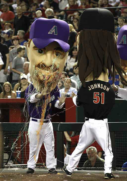 During the Arizona Diamondbacks legends race, the Mark Grace legend, gets doused with Silly String by the Randy Johnson legend during a race during a break in the fifth inning in an MLB baseball game against the Chicago Cubs Saturday, June 23, 2012, in Phoenix.&#40;AP Photo&#47;Ross D. Franklin&#41; <span class=meta>(AP Photo&#47; Ross D. Franklin)</span>