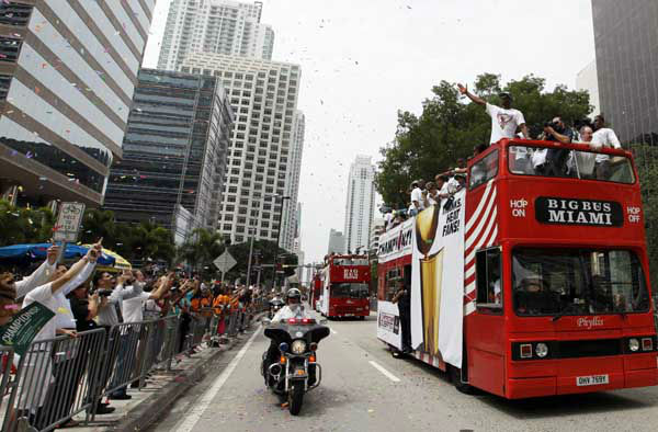 Miami Heat&#39;s Dwyane Wade waves from a doubledecker bus during a parade downtown in celebration of winning the NBA Finals basketball championship against the Oklahoma City Thunder, Monday, June 25, 2012, in Miami. &#40;AP Photo&#47;Lynne Sladky&#41; <span class=meta>(AP Photo&#47; Lynne Sladky)</span>