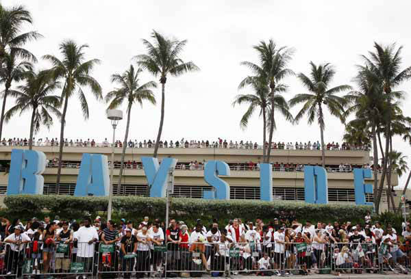 Miami Heat fans line the streets in front of Bayside Marketplace next to the American Airlines Arena where the Heat play, for a parade, Monday, June 25, 2012 in celebration of the Heat winning the NBA Finals basketball championship against the Oklahoma City Thunder, in Miami. &#40;AP Photo&#47;Wilfredo Lee&#41; <span class=meta>(AP Photo&#47; Wilfredo Lee)</span>