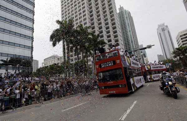 Buses carrying Miami Heat players ride through downtown during a parade in celebration of winning the NBA Finals basketball championship against the Oklahoma City Thunder, Monday, June 25, 2012, in Miami. &#40;AP Photo&#47;Lynne Sladky&#41; <span class=meta>(AP Photo&#47; Lynne Sladky)</span>